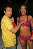 Adrianne Curry is oiled up by Christopher Knight at the Lingerie Bowl III Celebrity Quarterback Photo Shoot, Private Location, Long Beach, CA 05-27-05 — Stock Photo