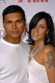Adam Beach and wife at the Premiere of Jenny McCarthys Dirty Love at the Arclight Theaters, Hollywood, CA 09-19-05 — Stock Photo