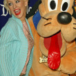 Christina Aguilera and Pluto - Stock Photo