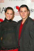 Katie Chonacas and Jose Antonio at the Red Party to Benefit the Life Through Art Foundation, hosted by the cast of 8 Simple Rules, Shrine Auditorium, Los Angeles, CA. 12-04-04 — Stock Photo