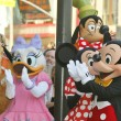 Pluto, Daisy Duck, Minnie Mouse, Mickey Mouse and Goofy help Donald Duck celebrate — Stock Photo