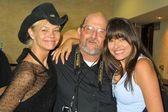 Julie McCullough and Devon De Vasquez with a crazed fan — Stock Photo