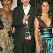 Постер, плакат: Carlos Santana and his wife Deborah with Salma Hayek