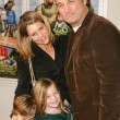 Постер, плакат: Jim Belushi and Jennifer Sloan with family