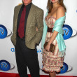 Постер, плакат: Alan Thicke and Tanya Callau at the Launch of AOL and Warner Bros In2TV The Museum of Television and Radio Beverly Hills CA 03 15 06