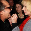 Постер, плакат: Jack Nicholson having food picked from his teeth by Sally Kellerman inside at Jennifer Nicholsons Fall 2006 Fashion Show Smashbox Culver City CA 03 22 06