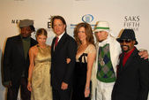 Black Eyed Peas with Tom Hanks and Rita Wilson at the Unforgettable Evening Benefit for EIFs Woman Cancer Research Fund. Regent Beverly Wilshire Hotel, Beverly Hills, CA. 03-01-06 — Stock Photo