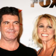 Постер, плакат: Simon Cowell Britney Spears at The X Factor Viewing Party Mixology Los Angeles CA 12 06 12