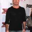 Постер, плакат: Simon Cowell at The X Factor Viewing Party Mixology Los Angeles CA 12 06 12