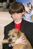 Liam Aiken and dog Hubble — Stock Photo