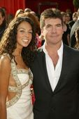 Simon Cowell and date — Stock Photo