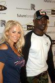 Djimon Hounsou and date Michelle — Stock Photo
