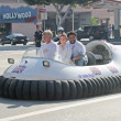Frankie Muniz and Anthony Anderson arrive on a hovercraft — Stock Photo #17584583