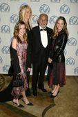 Dino De Laurentiis, wife Martha and daugthers Dina and Carolyna — Stock Photo