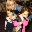 Jennifer Blanc with goddaughter Sierra, puppy Rowena and friend Cerena - Stock Photo