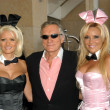 Hugh Hefner with Playboy Bunnies — Stock Photo
