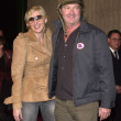 Постер, плакат: Randy Quaid and wife Evi