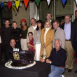 Постер, плакат: NYPD Blue cast and crew cut the cake