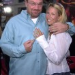 Tom Arnold and wife Shelby - Photo