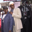 Постер, плакат: Samuel L Jackson with wife LaTanya and Darth Vader