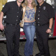 Julie Benz and firemen — Stock Photo #17962909