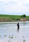 Pescador com fiação em roupas especiais. — Foto Stock