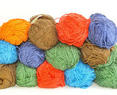 Multi-colored skeinsof yarn for knitting stacked one upon the other in the background . — Stock Photo