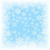 Winter background of falling snowflakes on a blurred background. — Stock Vector