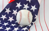 Baseball ball on a background of the American flag. — Stock fotografie