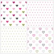 Set of four seamless patterns of hearts and polka dot pattern on white. — Stock Vector