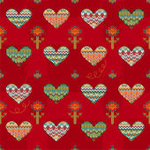 Seamless pattern of hearts and flowers knitting on a burgundy background. — Stock Vector