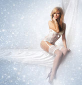 Portrait of young and attractive girl in sexy lingerie over winter backgrou — Стоковое фото