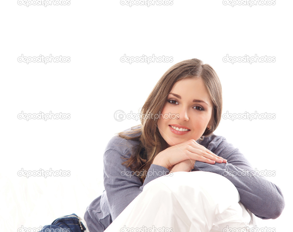 Young and beautiful woman on the sofa — Stock Photo #13844450