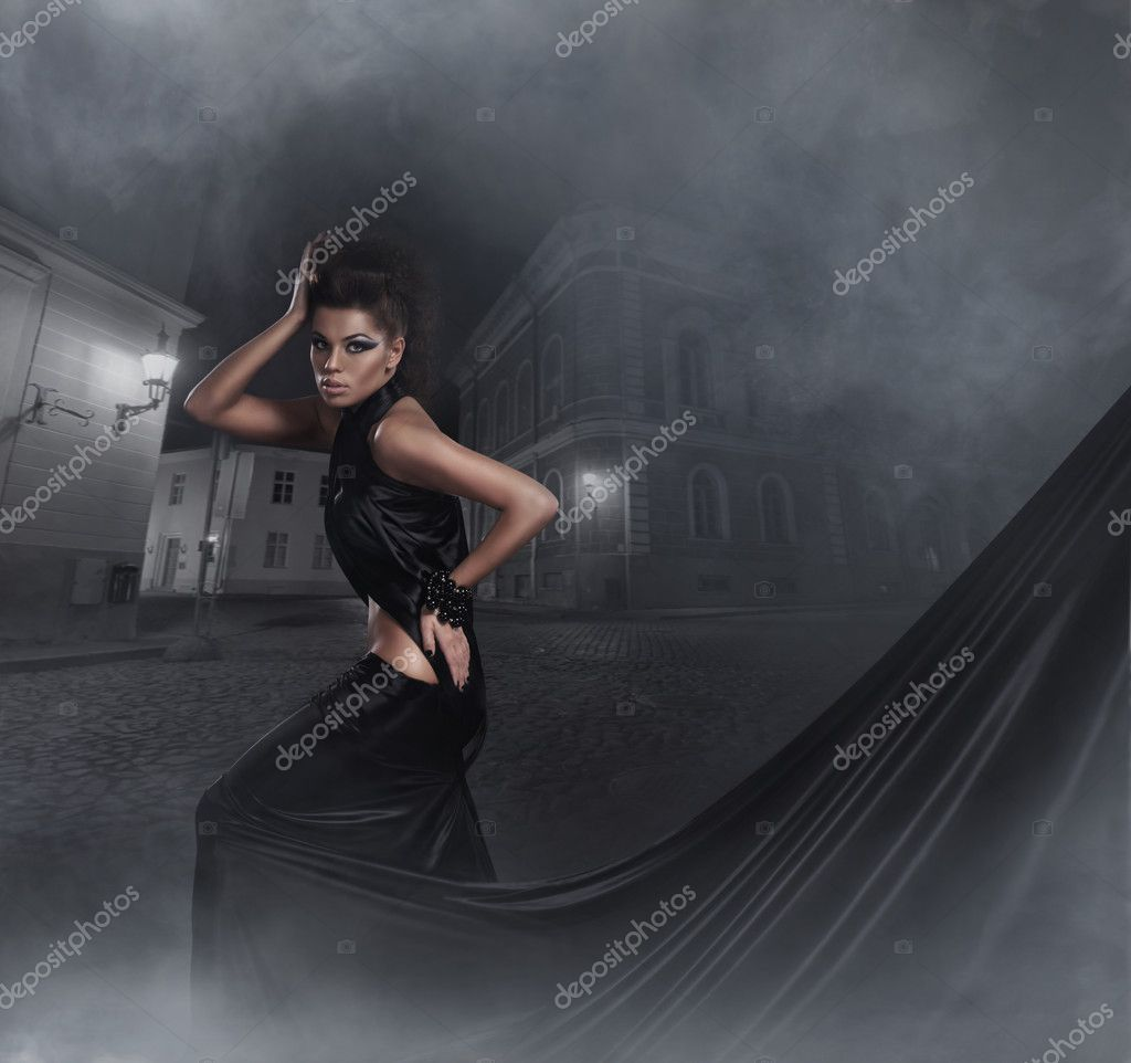 Fashion shoot of young sexy woman in black long dress — Stock Photo #13844457