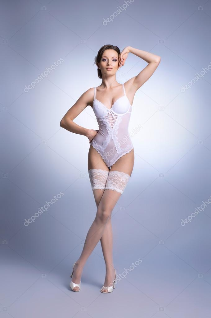 Young sexy bride in erotic lingerie over blue — Stock Photo #14912965