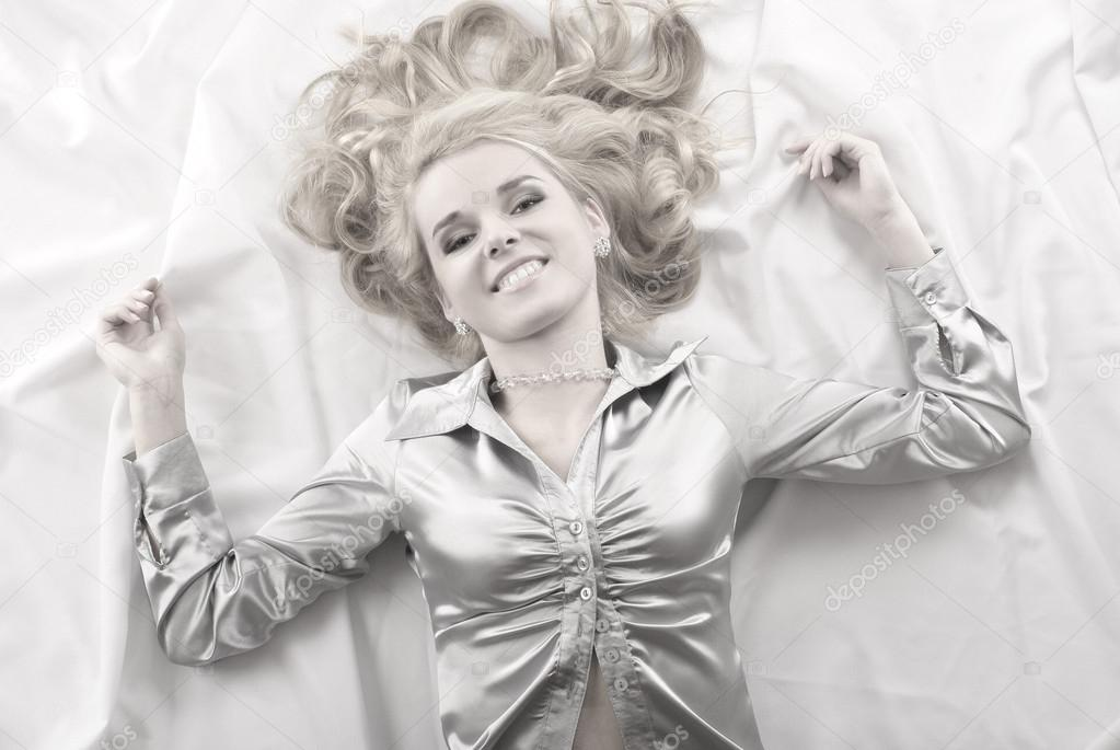 Attractive blond over silk background                   — Stock Photo #14913319