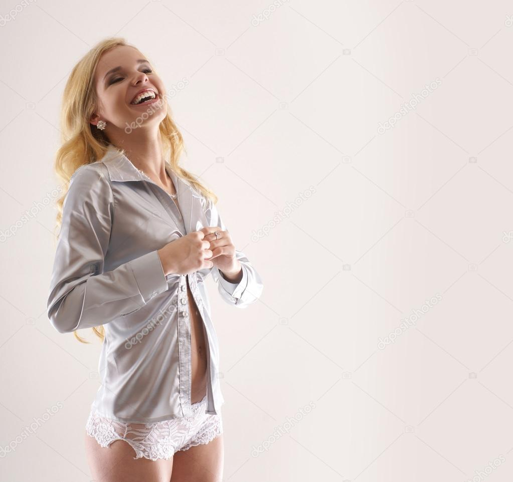 Attractive lady taking off shirt        Stock Photo #14913593