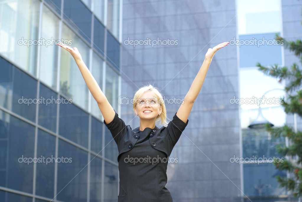 Happy businesswoman over street background               Stock Photo #14913745