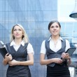 Business women over modern background — Stock Photo
