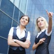 Foto Stock: Business women over modern background