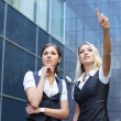 Stock Photo: Business women over modern background
