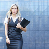 Business woman walking in the street — Stock Photo