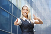 Young happy business woman over modern background — Stock Photo