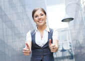 Young attractive business woman over modern background — Stock Photo