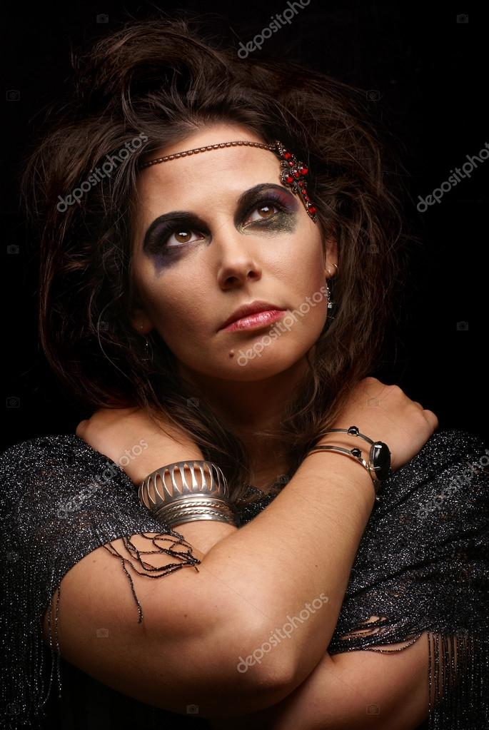 Portrait of witch over dark background                Stock Photo #14929873