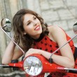Vintage image of young attractive girl and old scooter — Stock Photo #14934623