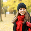 Young attractive girl in autumn park — Stock Photo #14930855