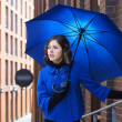 Fashion shoot of young attractive woman with umbrella — Stock Photo #14932249