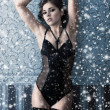 Fashion shoot of beautiful woman in luxury lingerie over Christmas background — Stock Photo #14934109