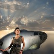 Young attractive female soldier with the plane and car — Stock Photo #14934521